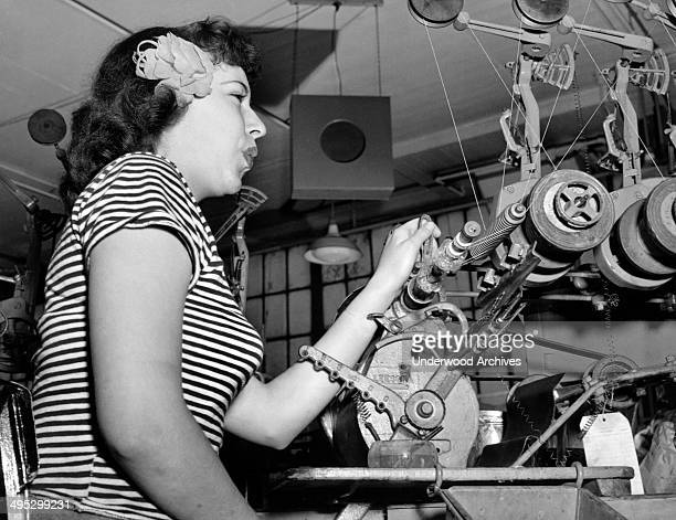 Former show girl Kaye Grimm now helps with the home front war effort at the RCA Victor plant Camden New Jersey January 1945 She whistles while she...