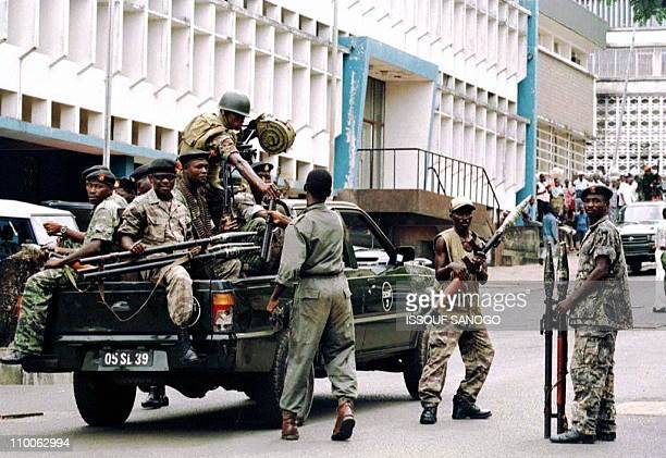 Former Sierra Leonean rebels now rallied to the ruling junta leave the Cenotaph in central Freetown where army remembrance day was celebrated 09...