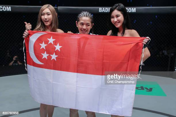 Former Singapore Olympic swimmer May Ooi comes back from a knockdown to defeat Ann Osman via submission during ONE Championship Quest For Greatness...