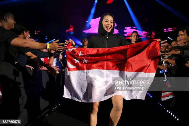 Former Singapore Olympic swimmer May Ooi makes her way to the cage against Ann Osman during ONE Championship Quest For Greatness at the Stadium...