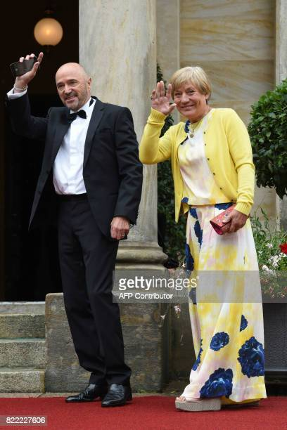 Former skiers Rosi Mittermaier and Christian Neureuther arrive at the Festival Theatre on July 25 in Bayreuth southern Germany ahead of the opening...