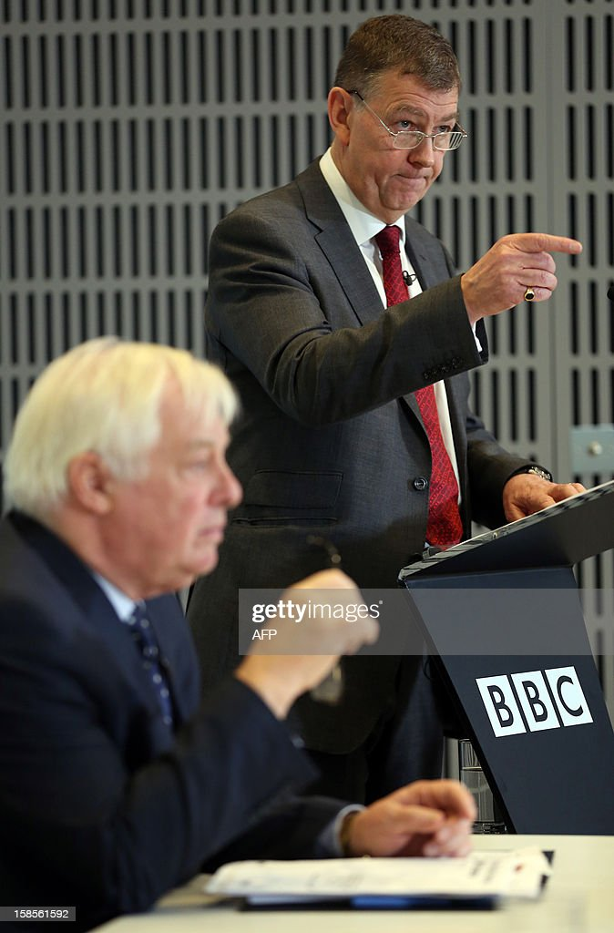 Former Sky News executive Nick Pollard (C) speaks during a press conference at BBC Broadcasting House in London on December 19, 2012 on the release of the Pollard Report into the BBC's handling of the child-sex abuse claims against late presenter Jimmy Savile with BBC Trust Chairman Chris Patten. The report strongly criticised the BBC's handling of allegations of child sex abuse against Savile but cleared the corporation of a cover-up. The report sparked the resignation of the BBC's deputy director of news, Stephen Mitchell, and led to the editor and deputy editor of the current affairs programme Newsnight at the centre of the scandal being replaced.