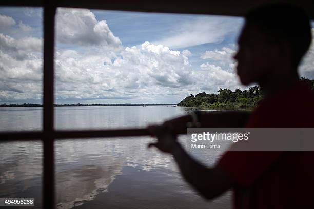 Former slave Elenilson de Conceição rides a ferry across the Araguaia river while crossing into Pará state Brazil on April 12 2015 It was his first...