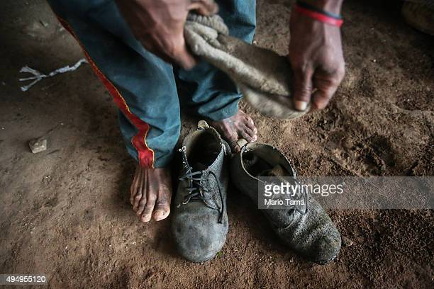 Former slave Francisco Rodrigues dos Santos takes off his shoes in his house at the Nova Conquista settlement on April 8 2015 in Monsenhor Gil Piauí...