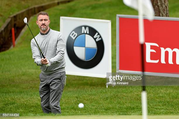 Former snooker player Stephen Hendry chips during the ProAm prior to the BMW PGA Championship at Wentworth on May 25 2016 in Virginia Water England