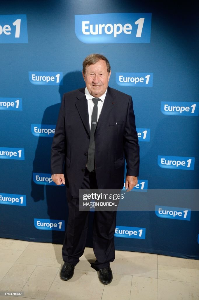 Former soccer coach and French radio host Guy Roux poses during a photocall as part of the presentation of the 2013/2014 programs of the Europe 1 radio station, on September 4, 2013 in Paris.