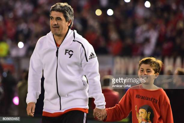 Former soccer player Ariel Ortega walks onto the field prior Fernando Cavenaghi's farewell match at Monumental Stadium on July 01 2017 in Buenos...