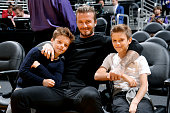 Former soccer player David Beckham and his children attends a game between the Utah Jazz and Los Angeles Lakers at STAPLES Center on October 19 2014...