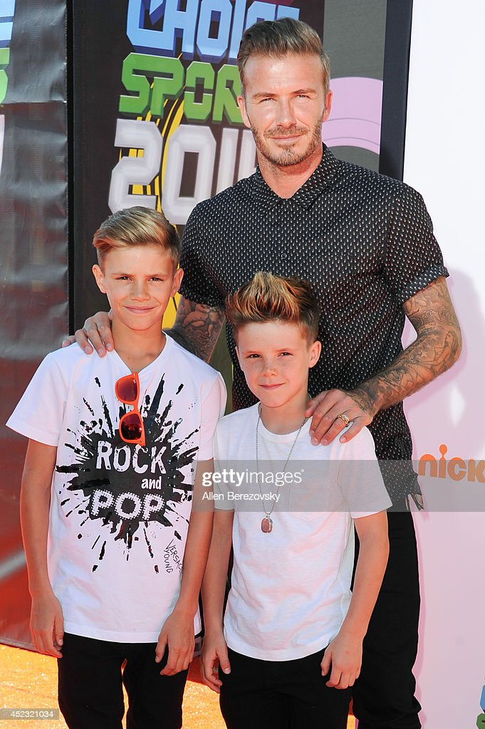 Former soccer player David Beckham, Romeo James Beckham (L) and Cruz David Beckham attend Nickelodeon Kids' Choice Sports Awards 2014 at Pauley Pavilion on July 17, 2014 in Los Angeles, California.