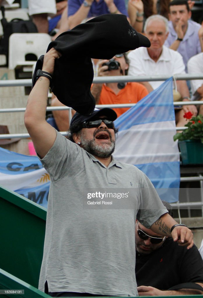 Former soccer player Diego Armando Maradona of Argentina celebrates during the match between Argentina and Czech Republic as part of the second day of the Davis Cup Semi-final at Mary Tern de Weiss Stadium on September 15, 2012 in Buenos Aires, Argentina.