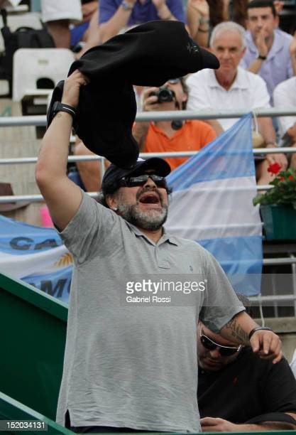 Former soccer player Diego Armando Maradona of Argentina celebrates during the match between Argentina and Czech Republic as part of the second day...