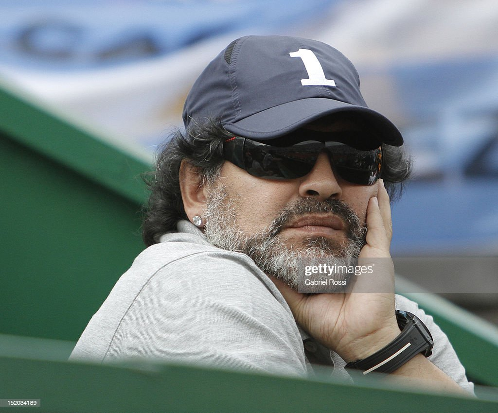 Former soccer player Diego Armando Maradona of Argentina watches the match between Argentina and Czech Republic as part of the second day of the Davis Cup Semi-final at Mary Tern de Weiss Stadium on September 15, 2012 in Buenos Aires, Argentina.