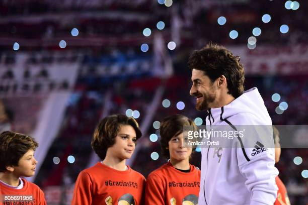 Former soccer player Pablo Aimar walks onto the field prior Fernando Cavenaghi's farewell match at Monumental Stadium on July 01 2017 in Buenos Aires...