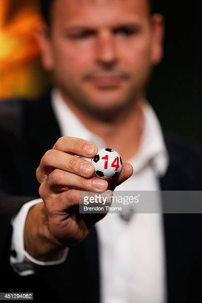 Former Socceroo Mile Sterjovski draws a team to compete in the official FFA Cup draw at Fox Sports Studios on June 27 2014 in Sydney Australia