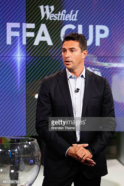 Former Socceroo Paul Okon speaks on camera during the official FFA Cup draw at Fox Sports Studios on June 27 2014 in Sydney Australia
