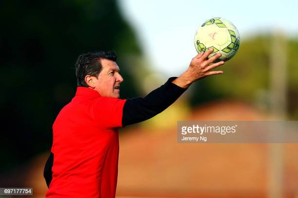 Former Socceroo player and coach of Parramatta FC Marshall Soper juggles a ball during the NSW NPL Men's match between Sydney Olympic FC and...