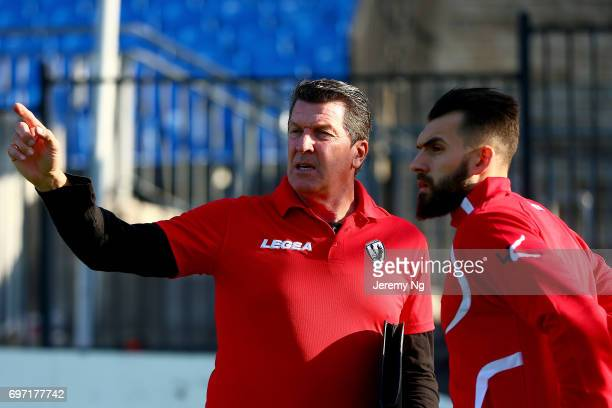 Former Socceroo player now coach of Parramatta FC Marshall Soper gives instructions during the NSW NPL Men's match between Sydney Olympic FC and...