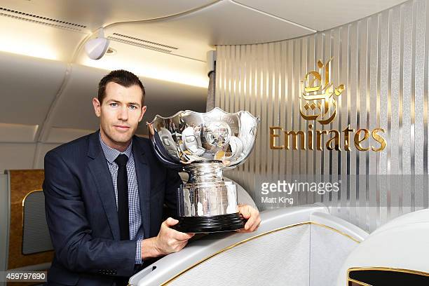 Former Socceroos Brett Emerton poses with the Asian Cup trophy after its arrival on an Emirates A380 during the Asian Cup Trophy Tour at Sydney...