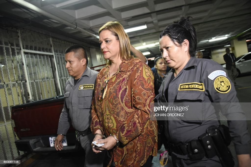 Former Social Welfare Deputy Secretary Anahi Keller is escorted by police agents to a courtroom after being arrested in connection with the fire at a children's shelter that killed 40 girls in Guat...