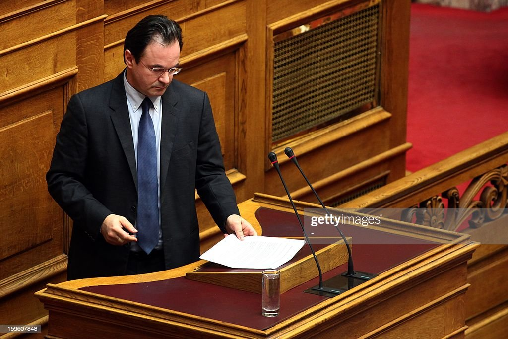 Former socialist Finance minister George Papaconstantinou prepares before addressing the Greek Parliament in Athens on January 17, 2013. Greece's parliament was to determine today whether to set up a commission to investigate an alleged tax cover-up by former ministers, and possibly two ex-prime ministers as well. The tax scandal involves a list of names of Greeks with accounts at HSBC bank in Switzerland who are suspected of tax evasion. Papaconstantinou is accused of tampering with the list, which included the names of some of his relatives. AFP PHOTO / FOSPHOTOS