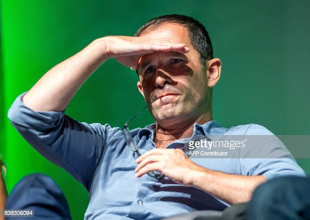Former socialist presidential candidate now leader of the 'mouvement du 1er juillet' Benoit Hamon gestures as he attends a Europe Ecologie Les Verts...