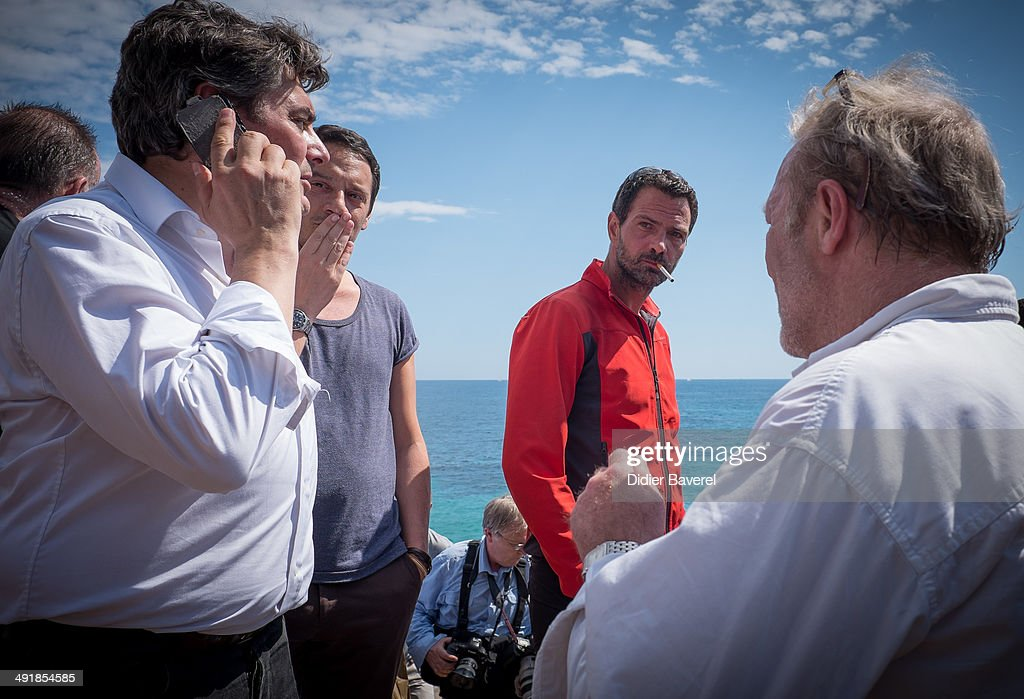 Former Societe General Bank trader Jerome Kerviel and his lawyer David Koubbi arrive near the French Border where he is waited by Police on May 17...