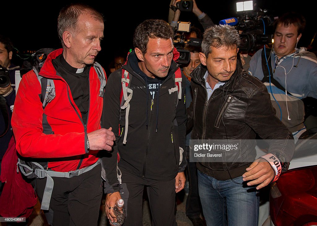 Former Societe General trader <a gi-track='captionPersonalityLinkClicked' href=/galleries/search?phrase=Jerome+Kerviel&family=editorial&specificpeople=4840386 ng-click='$event.stopPropagation()'>Jerome Kerviel</a>, assisted by priest Patrice Gourrier (L), surrenders to police at the French border on May 18, 2014 in Menton, France. Kerviel, convicted of one of the largest trading frauds in history that resulted in a 4.9 billion euro loss, was sentenced in France to three years in prison.