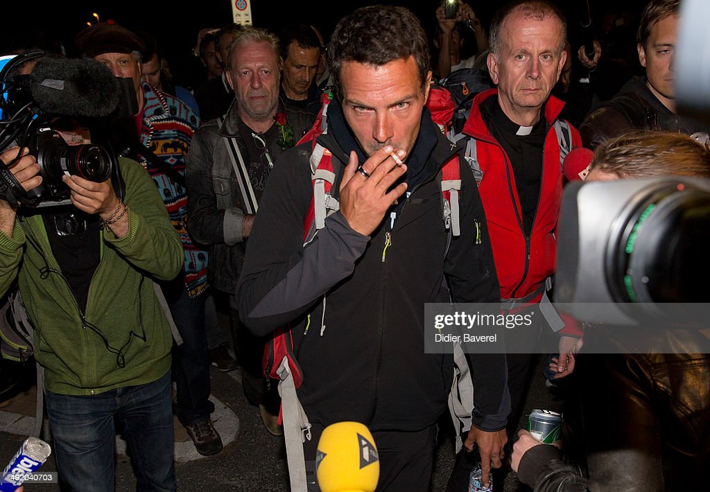 Former Societe General trader Jerome Kerviel assisted by priest Patrice Gourrier surrenders to police at the French border on May 18 2014 in Menton...