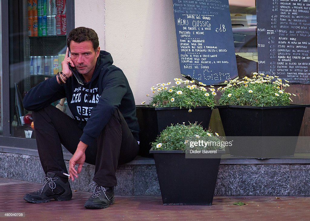 Former Societe General trader Jerome Kerviel makes a stop on his way to the French border to surrender to police on May 18 2014 in Menton France...