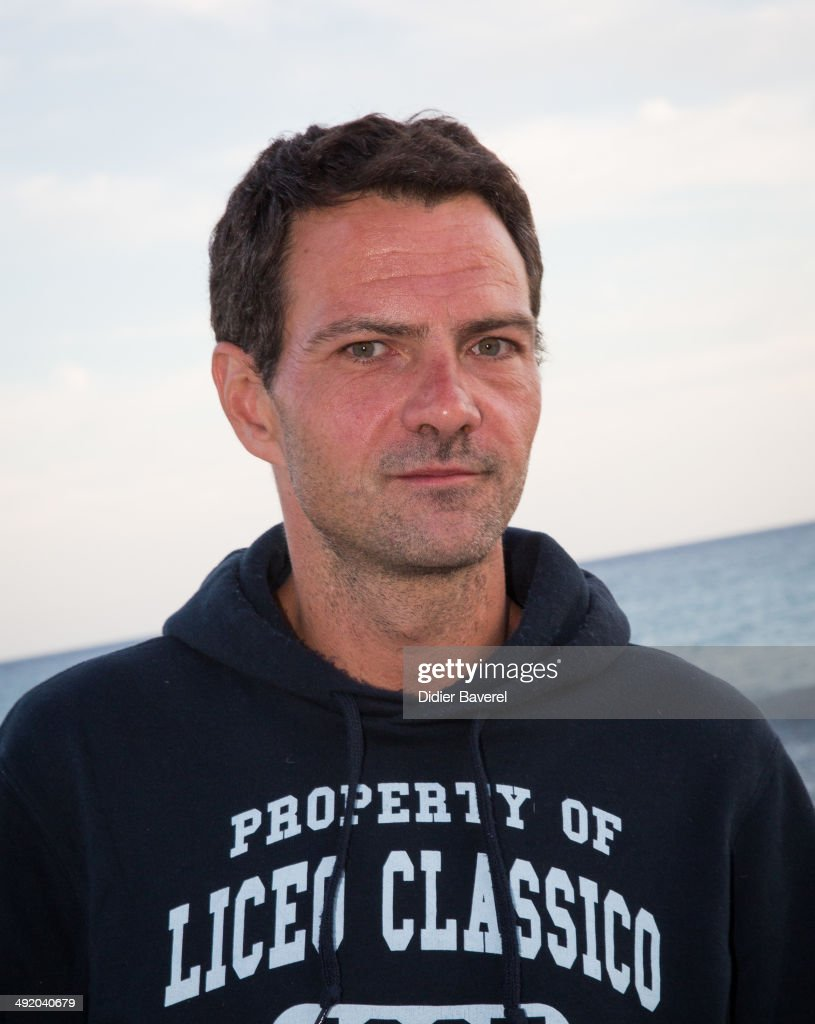 Former Societe General trader Jerome Kerviel poses for a photo on his way to the French border to surrender to police on May 18 2014 in Menton France...