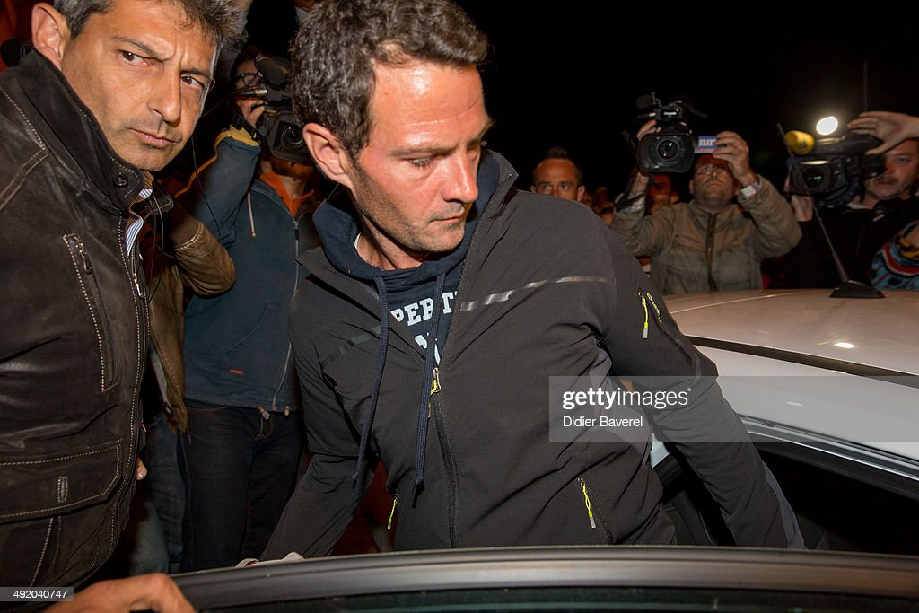 Former Societe General trader Jerome Kerviel surrenders to police at the French border on May 18 2014 in Menton France Kerviel convicted of one of...