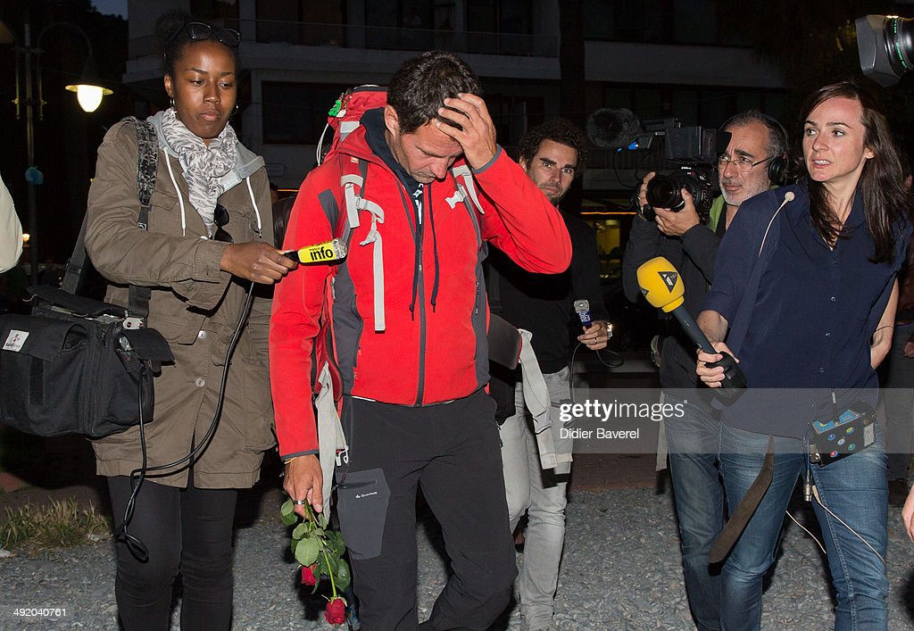 Former Societe General trader Jerome Kerviel walks to the French border surrounded by journalists to surrender to police on May 18 2014 in Menton...