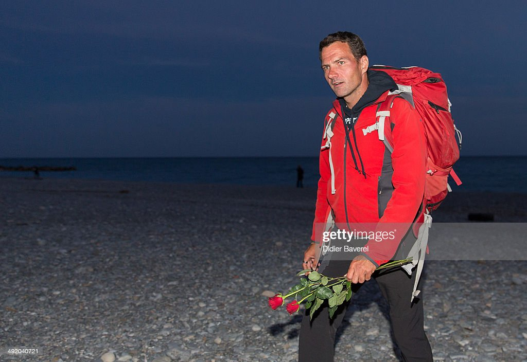 Former Societe General trader Jerome Kerviel walks to the French border to surrender to police on May 18 2014 in Menton France Kerviel convicted of...
