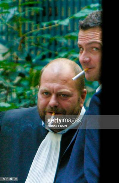 Former Societe Generale trader Jerome Kerviel smokes a cigarette with his lawyer Eric DupondMoretti at the financial police headquarters in Paris...