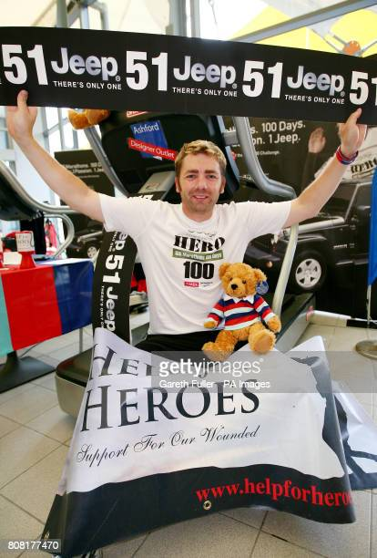 Former soldier Mike Buss celebrates completing 51 marathons in 51 days and setting a new world record as part of his Hero 100 challenge to run 100...