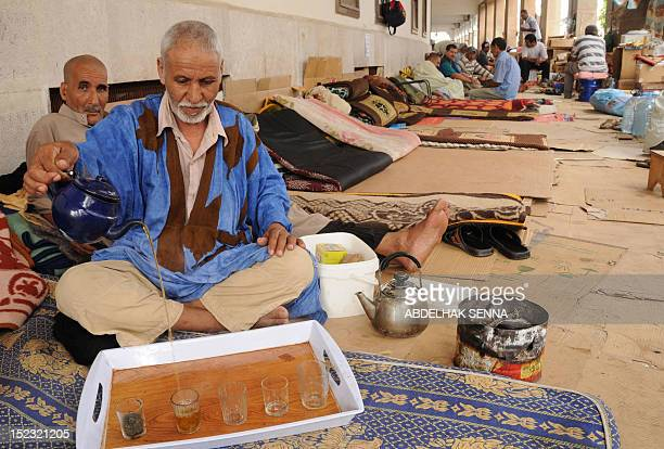 A former soldier pours tea as he and others who were held as prisoners of war by the Polisario Front separatist rebels are seen during a sitin close...