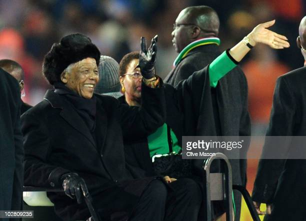 Former South Africa President Nelson Mandela and wife Graca Machel wave to the crowds prior to the 2010 FIFA World Cup South Africa Final match...