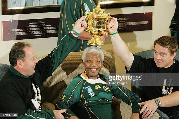 Former South Africa President Nelson Mandela poses with South Africa Rugby Union coach Jake White South Africa Rugby Union captain John Smit and the...