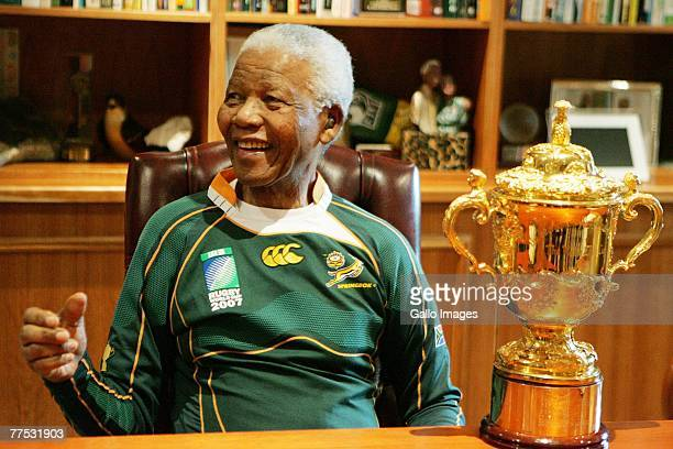 Former South Africa President Nelson Mandela poses with the WebbEllis cup during the Springboks visit to Nelson Mandela at his residence on October...
