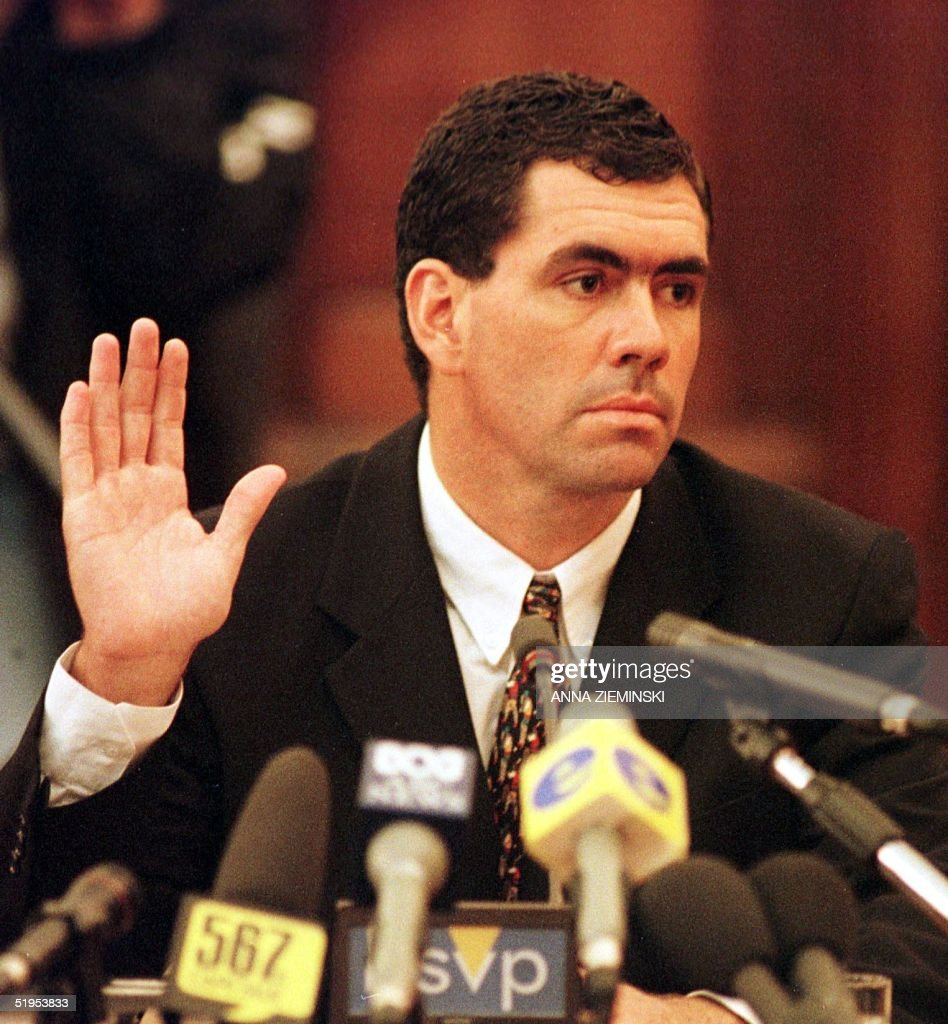 Former South African cricket captain Hansie Cronje raises his hand to take the oath prior to testifying before the King Commission of Inquiry into...