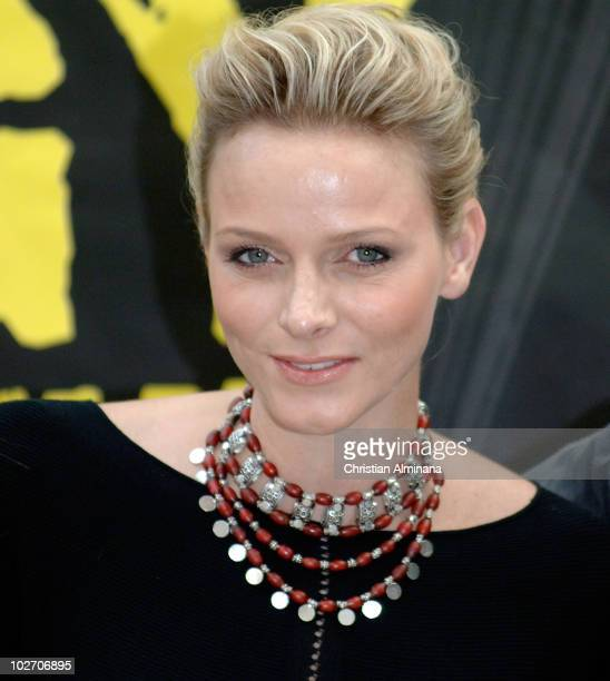 Former South African Olympic backstroke swimmer and fiancée of Prince Albert II of Monaco Charlene Wittstock poses before an openair concert on July...