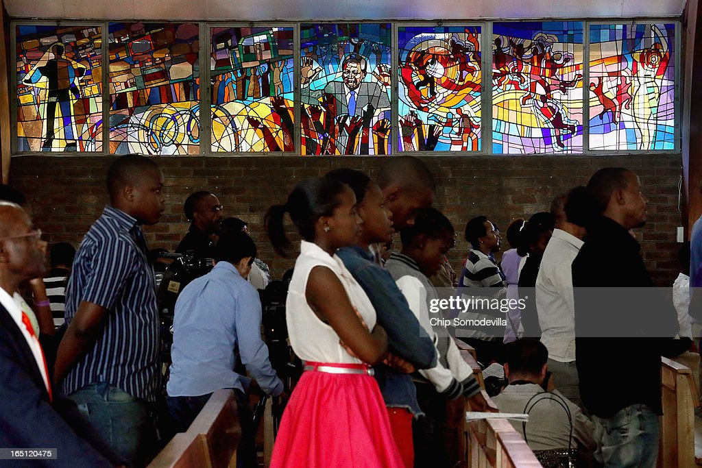 Former South African President Nelson Mandela and the struggle against apartheid are depicted in a stained glass window as congregants pray during Easter services at Regina Mundi Catholic Church in the Soweto area March 31, 2013 in Johannesburg, South Africa. A central gathering place during he anti-apartheid struggle, the church held prayers for former South African President Nelson Mandela, 94, who is in the hospital for the third time since December with lung problems. Referring to Mandela by clan name, Madiba, President Jacob Zuma said, 'We appeal to the people of South Africa and the world to pray for our beloved Madiba and his family and to keep them in their thoughts.' Mandela's lungs were damaged when he contracted tuberculosis during his 27 years in the infamous Robben Island prison. Mandela became the nation's first democratically elected president in 1994 following the end of apartheid.