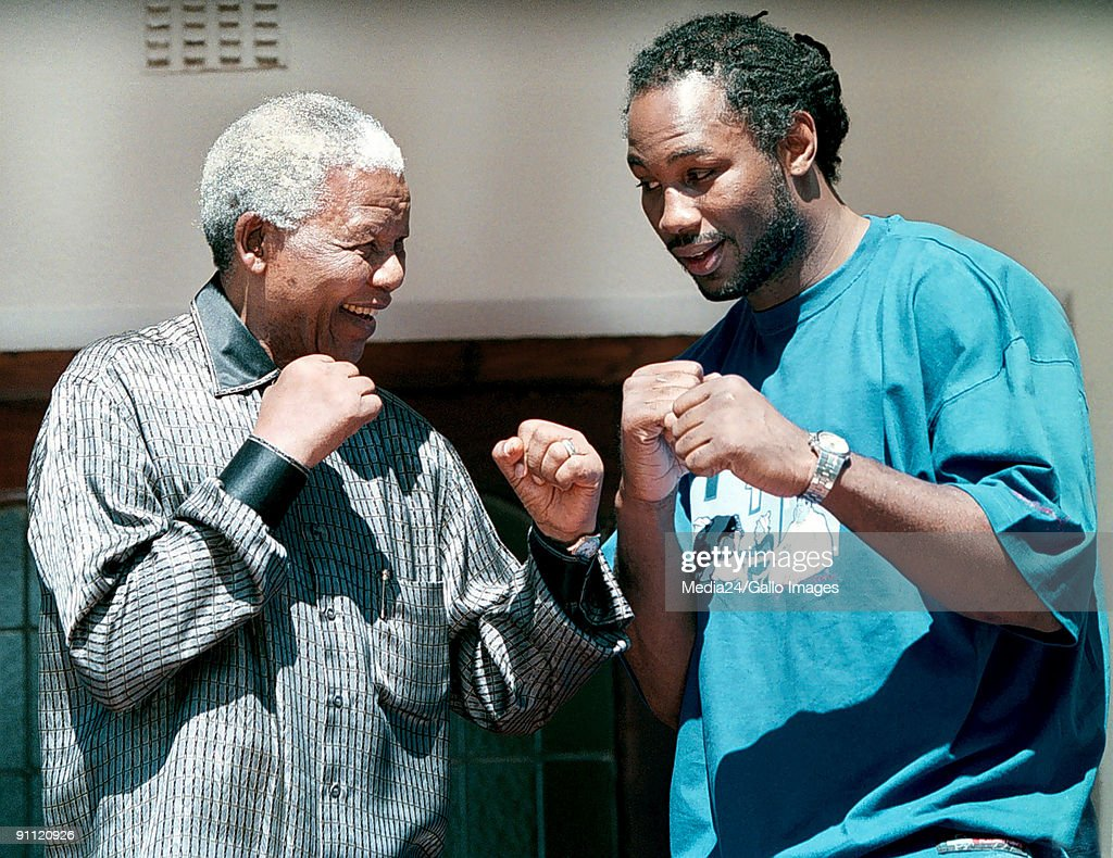 Former South African president <a gi-track='captionPersonalityLinkClicked' href=/galleries/search?phrase=Nelson+Mandela&family=editorial&specificpeople=118613 ng-click='$event.stopPropagation()'>Nelson Mandela</a> and world heavyweight boxer Lennox Lewis take up boxing stances, in a mock fight at Mandela's residence. South Africa.