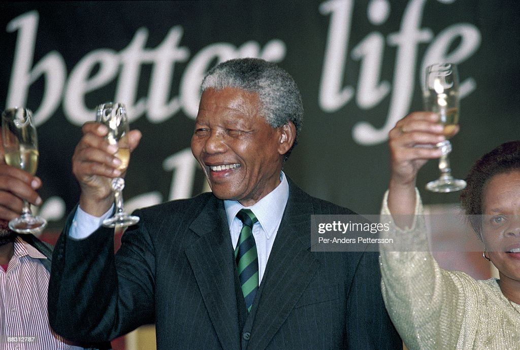 Former South African president <a gi-track='captionPersonalityLinkClicked' href=/galleries/search?phrase=Nelson+Mandela&family=editorial&specificpeople=118613 ng-click='$event.stopPropagation()'>Nelson Mandela</a> drinks champagne at a victory party held at Carlton Hotel on May 2, 1994 in Johannesburg, South Africa. The historic democratic election was held on April 27, 1994 and Mr. Mandela and his party, the African National Congress, won. Mr. Mandela became the first black democratic elected president in South Africa. He retired from office after one term in June 1999.
