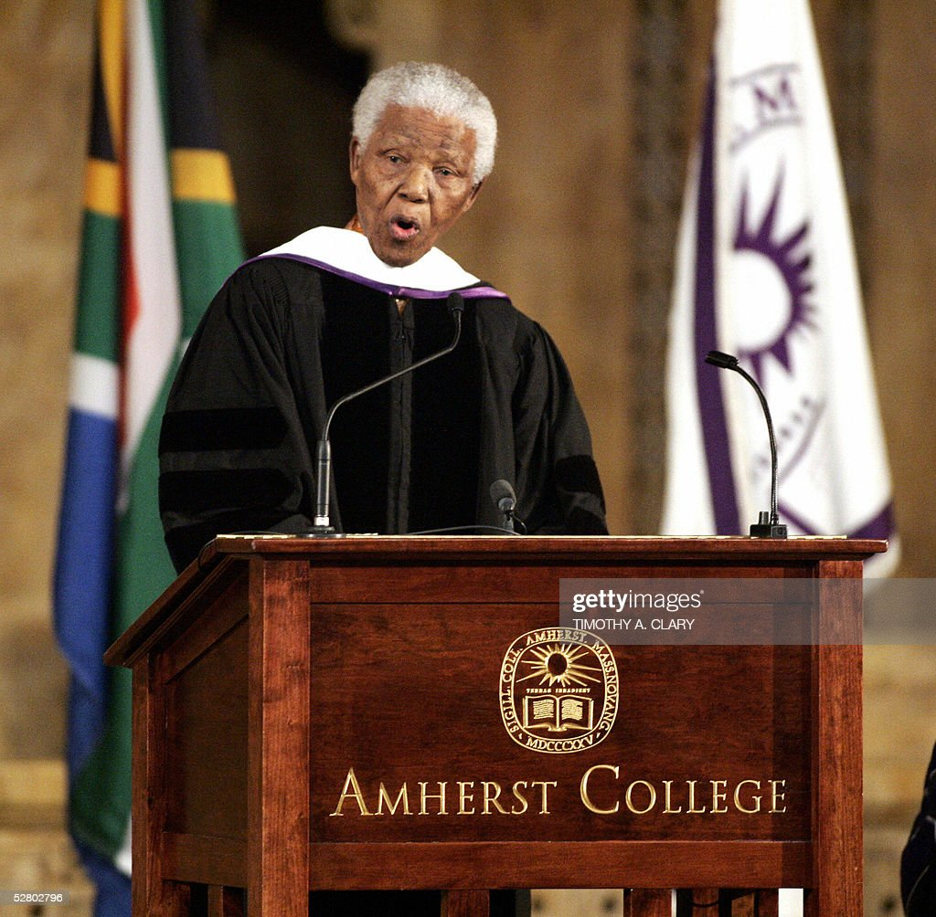 Former South African President Nelson Mandela gives a speech after being awarded an Honorary Degree from Amherst College in Massaschusetts during an...