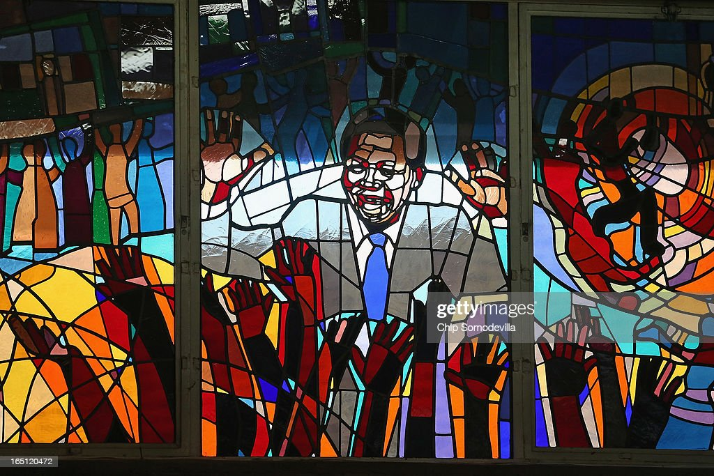 Former South African President Nelson Mandela is depicted in a stained glass window during Easter services at Regina Mundi Catholic Church in the Soweto area March 31, 2013 in Johannesburg, South Africa. A central gathering place during he anti-apartheid struggle, the church held prayers for Mandela, 94, who is in the hospital for the third time since December with lung problems. Referring to Mandela by clan name, Madiba, President Jacob Zuma said, 'We appeal to the people of South Africa and the world to pray for our beloved Madiba and his family and to keep them in their thoughts.' Mandela's lungs were damaged when he contracted tuberculosis during his 27 years in the infamous Robben Island prison. Mandela became the nation's first democratically elected president in 1994 following the end of apartheid.