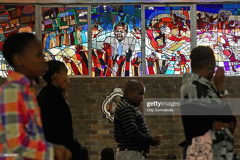 Former South African President Nelson Mandela is depicted in a stained glass window as congregants pray during Easter services at Regina Mundi Catholic Church in the Soweto area March 31, 2013 in Johannesburg, South Africa. A central gathering place during he anti-apartheid struggle, the church held prayers for Mandela, 94, who is in the hospital for the third time since December with lung problems. Referring to Mandela by clan name, Madiba, President Jacob Zuma said, 'We appeal to the people of South Africa and the world to pray for our beloved Madiba and his family and to keep them in their thoughts.' Mandela's lungs were damaged when he contracted tuberculosis during his 27 years in the infamous Robben Island prison. Mandela became the nation's first democratically elected president in 1994 following the end of apartheid.