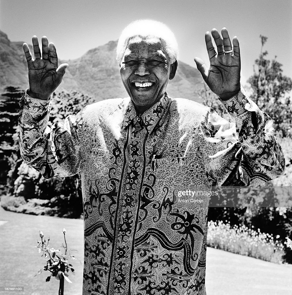 Former South African President Nelson Mandela is photographed in December 2003 outside his home in Cape Town, South Africa.