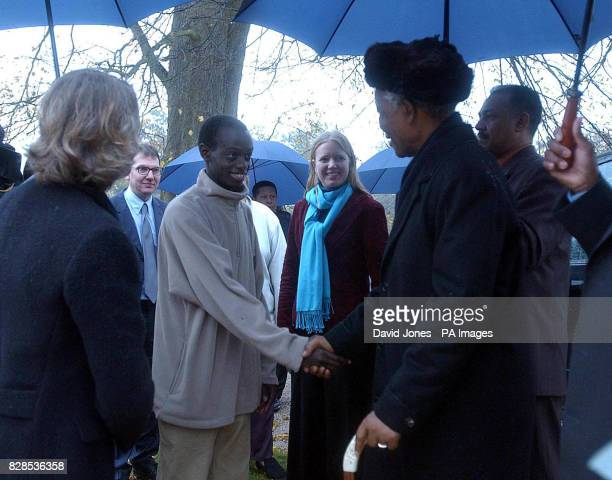 Former South African president Nelson Mandela meets 16yearold Rwandan refugee Onesmus during a visit to the grave of Diana Princess of Wales at...