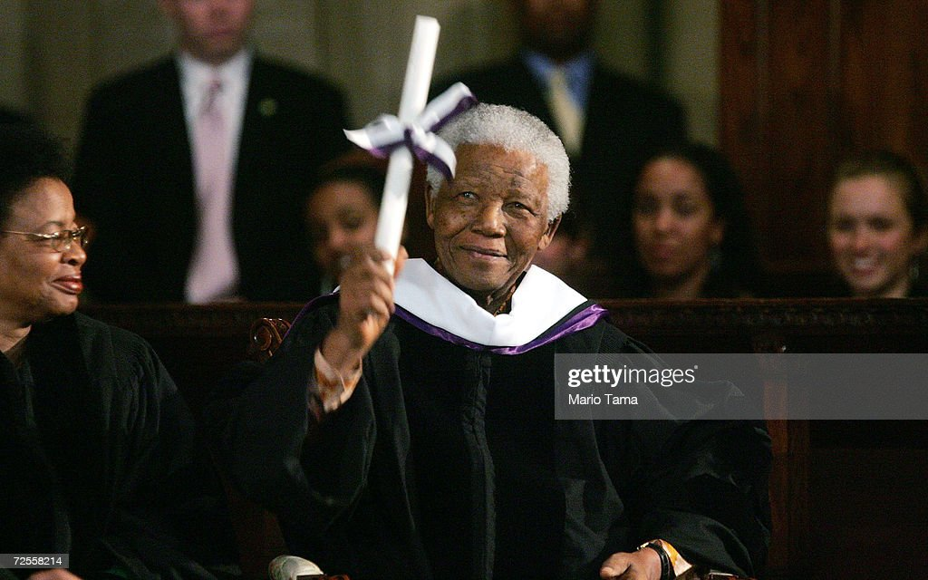 Former South African president Nelson Mandela smiles after receiving an honorary degree from Amherst College at St Bartholomew Church May 12 2005 in...